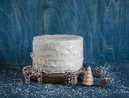 ganache: Triple chocolate layer cake. Milk, white and dark chocolate cake on wooden background. Christmas background