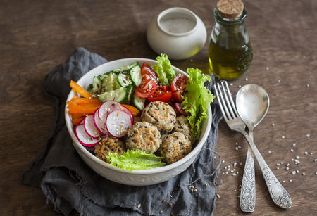 Quinoa meatballs and vegetable salad. Buddha bowl on a wooden table, top view.  Healthy, diet, vegetarian food concept. Flat lay 版權商用圖片