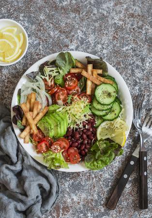 Crunchy taco vegetables salad bowl. Delicious food, top view