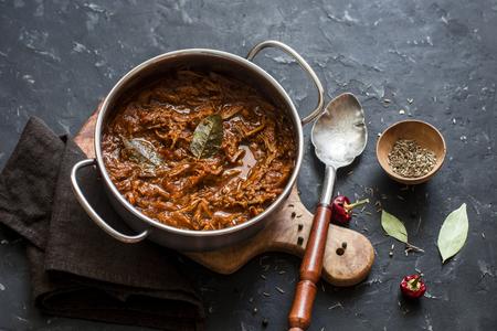 Slow cooker beef ragu. Crock pot braised beef on dark background. Delicious comfort healthy food Stock Photo