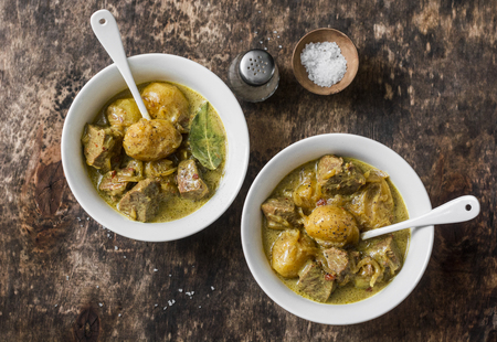 Beef potato massaman curry  on wooden background, top view. Comfort, delicious food in the asian style Stockfoto