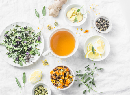 Flat lay liver detox antioxidant tea and the ingredients for it on a light background, top view. Herbal homeopathic recept