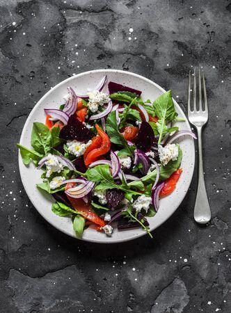 Beetroot, smoked salmon, arugula, soft cheese salad on dark background, top view Stock Photo