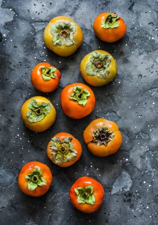 Fresh ripe persimmon on a dark background, top view Stock Photo