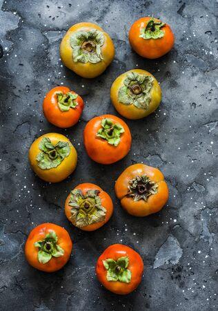 Fresh ripe persimmon on a dark background, top view Stock fotó