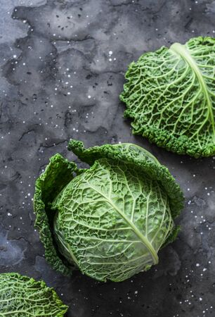 Fresh savoy cabbage on a dark background. the view from the top. Copy space