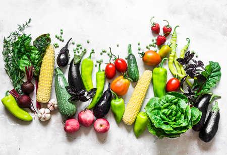 Summer harvest - fresh organic vegetables fruits background. Organic garden vegetables, berries, fruit on a light background, top view