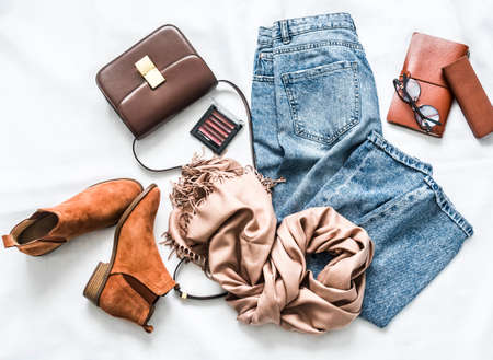 Women's clothing and accessories on a light background, top view Stock Photo