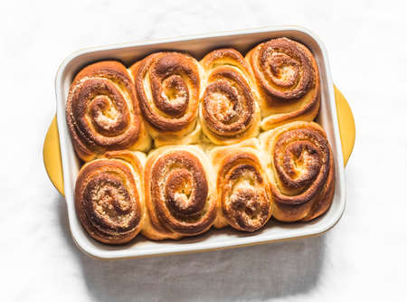 Lemon sugar rolled buns in a baking dish on a light background, top view 版權商用圖片