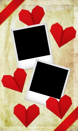 Place the photo of you and your love/Composition for Valentine's day with two photographs and beautiful origami hearts on grunge background  Stock Photo - 17132148