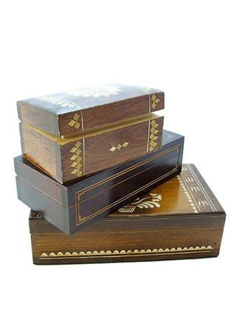 Wooden jewellery boxesThree wooden jewellery boxes piled one on top on an other photo