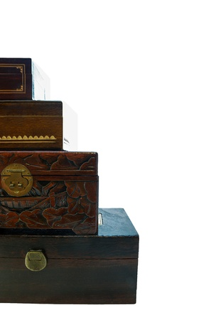 Wooden jewellery boxesWooden jewellery boxes piled one on top of the other, on white photo
