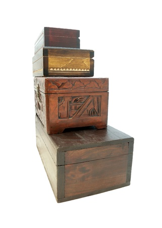 Wooden jewellery boxesWooden jewellery boxes piled one on top of the other, side view on white photo