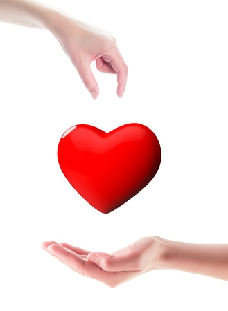 Organ donation Hands one giving 3d glossy heart, the other receiving, isolated on white Stock Photo - 21973262