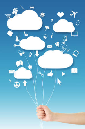 Hand holding clouds balloons  Cloud computing concept, where hand holding clouds  balloons  and various web icons floating around them blue sky background photo