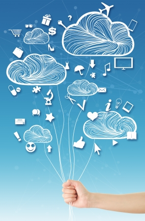 Hand holding clouds balloons  Cloud computing concept, where hand holding clouds  balloons  and various web icons floating around them, blue sky abstract shapes background photo