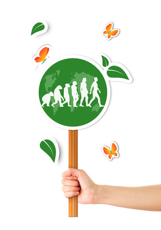 Hand holding green world sign with evolution man Stock Photo - 23966638