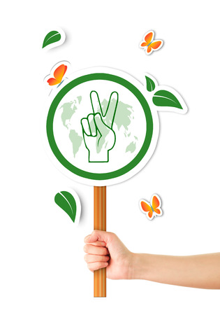 Hand holding green world peace sign photo