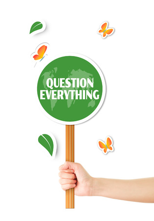 Hand holding green question everything sign photo