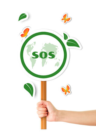 Hand holding sos green planet sign photo