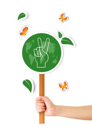 social awareness symbol: Hand holding green world peace sign Stock Photo