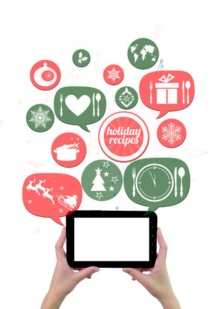 Online winter holiday recipe website business template. Hand holding tablet bubblesbuttons floating of it with festive holiday icons photo
