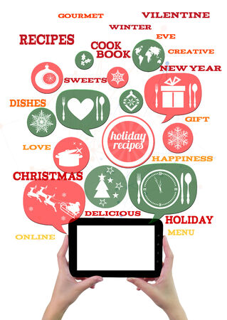 Online winter holiday recipe website business template. Hand holding tablet bubblesbuttons floating of it with festive holiday icons and text. photo