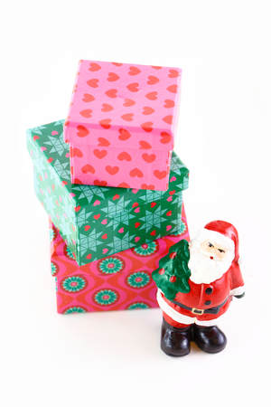 Santa with Christmas tree and gifts isolated on white photo