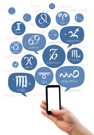 Hand holding smartphone with online astrology site template photo