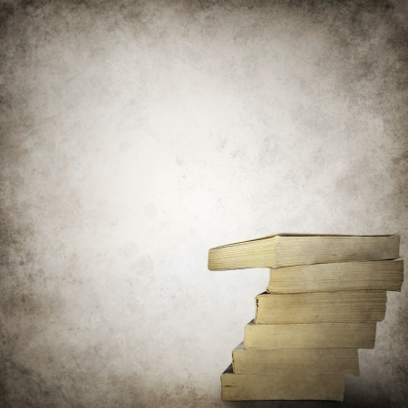 Grunge background template with stack of books photo