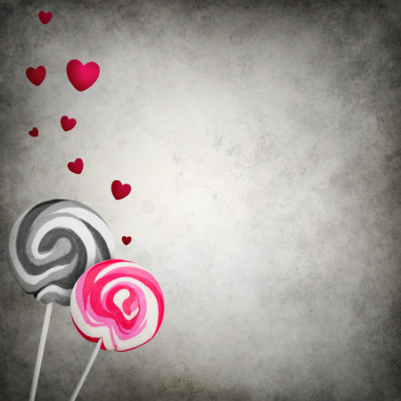 Unmatched lollipops with floating hearts on grunge background photo
