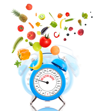 Diet concept with clock, scale dial, fruits and vegetables.  photo