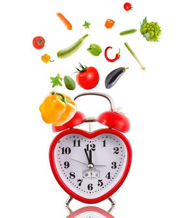 Clock in shape of heart with vegetables. Reklamní fotografie
