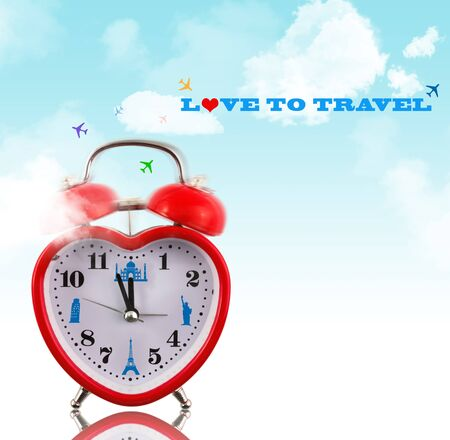 Love to travel! Heart clock with landmarks and sky photo