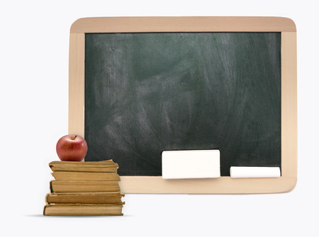 Empty blackboard with wooden frame, old books and apple photo