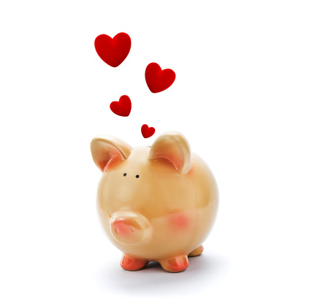 Piggy bank with red hearts above photo