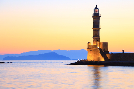 Seascape view of lighthouse in dusk colors Chania Crete