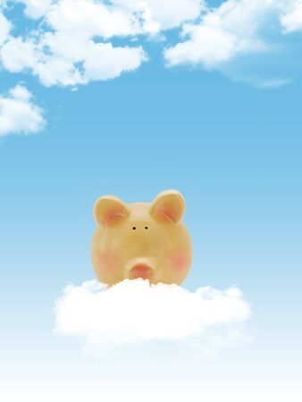 Piggy bank with blue sky and clouds, copy-space  photo