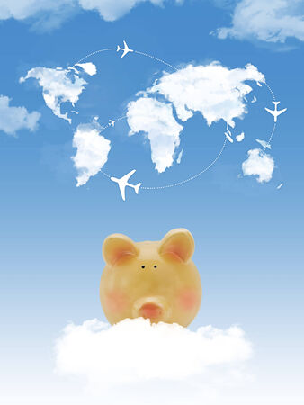 Piggy bank on cloud with world map shape clouds and airplanes photo