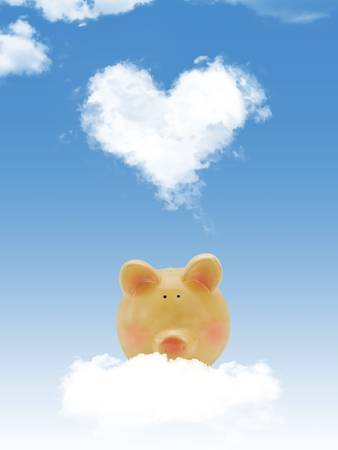 Piggy bank on cloud with heart shape cloud and blue sky photo