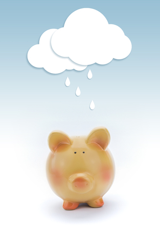 bad fortune: Piggy bank with paper cloud and rain above.