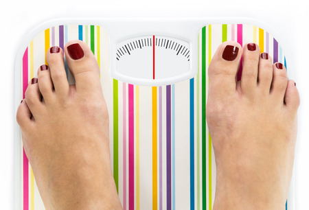 Feet on bathroom scale with clean dial with lines no numbers Stock Photo