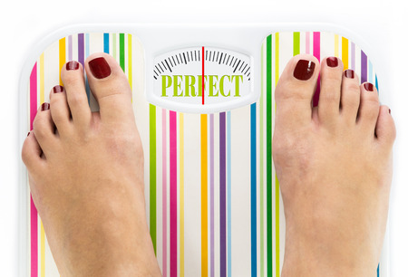 Feet on bathroom scale with word Perfect on dial Stock Photo