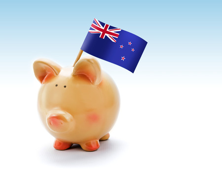 Piggy bank with national flag of New Zealand photo