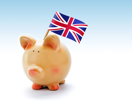 Piggy bank with national flag of United Kingdom photo