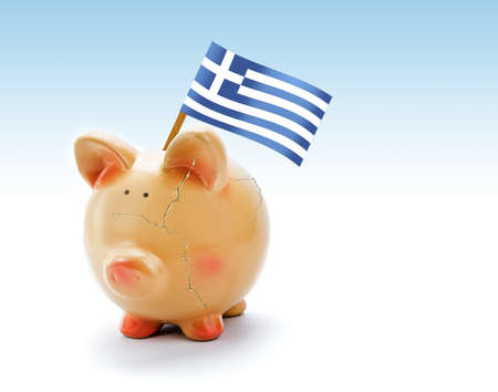 Piggy bank with cracks and national flag of Greece photo