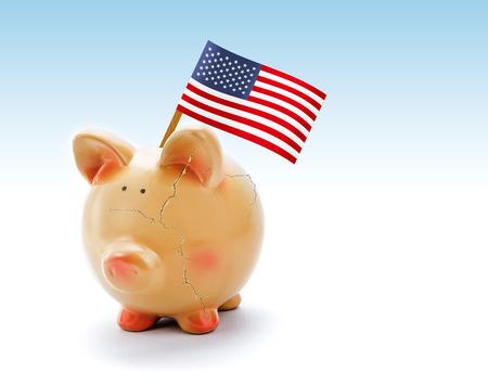 Piggy bank with cracks and national flag of USA photo