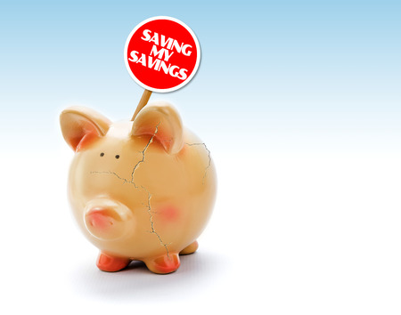 Broken piggy bank with cracks and Saving my Savings tag photo