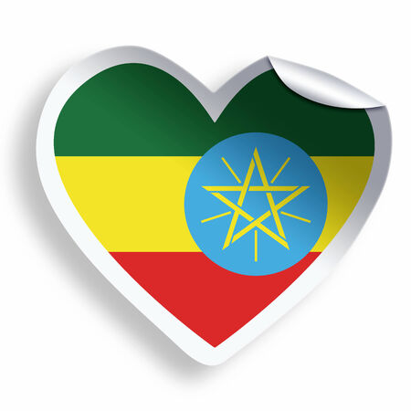 Heart sticker with flag of Ethiopia isolated on white photo