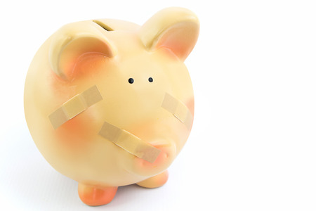 Piggy bank with medical patches, isolated on white background photo
